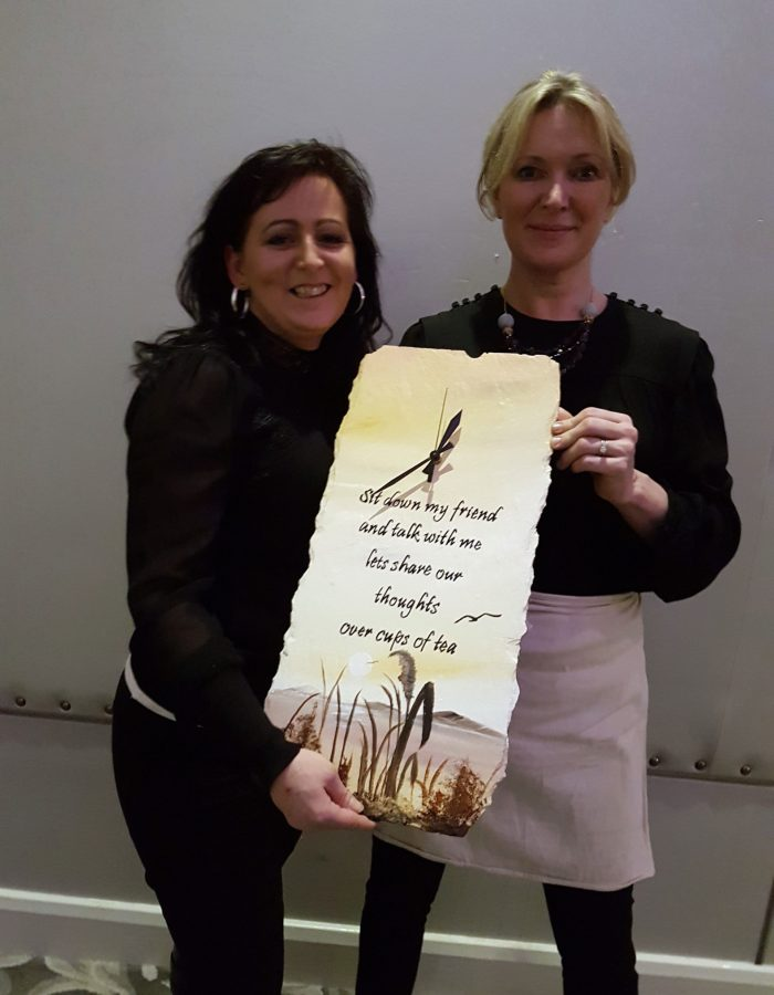 Kate presKate presents one of her hand crafted clocks to Rachel Allennts one of her clocks which she designed to Rachel Allen